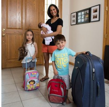 Nadia Day, MD, with her children Ella (5), Jackson (3) and Amelia (1 month).