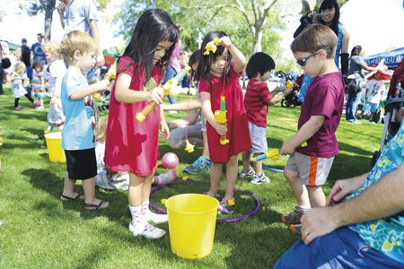 Kids catching fish at the Ultimate Play Date at the Scottsdale Public Library. Photo by Tac Coluccio.