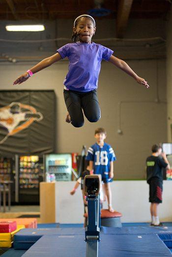 FlipDunk Phoenix balance beam jump