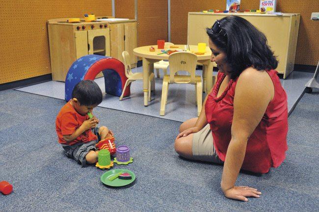 Veronica Castillo of Phoenix and her grandson, Lorenzo Castillo (4), visited the eating assessment playroom at an open house for the Children's Developmental Center. Photo by Daniel Friedman.