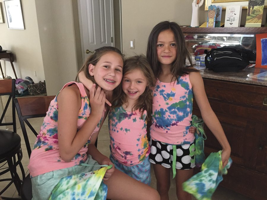 "Martha Christiansen's grandchildren (from left) Madison Mobley (12), of Golden, Colorado, Cate Mobley (6), of Phoenix, and Sadie Mobley (9), of Golden, wear the tie-dye T-shirts they made at ""Camp Nana and Poppy."" Photo courtesy of Martha Christiansen."
