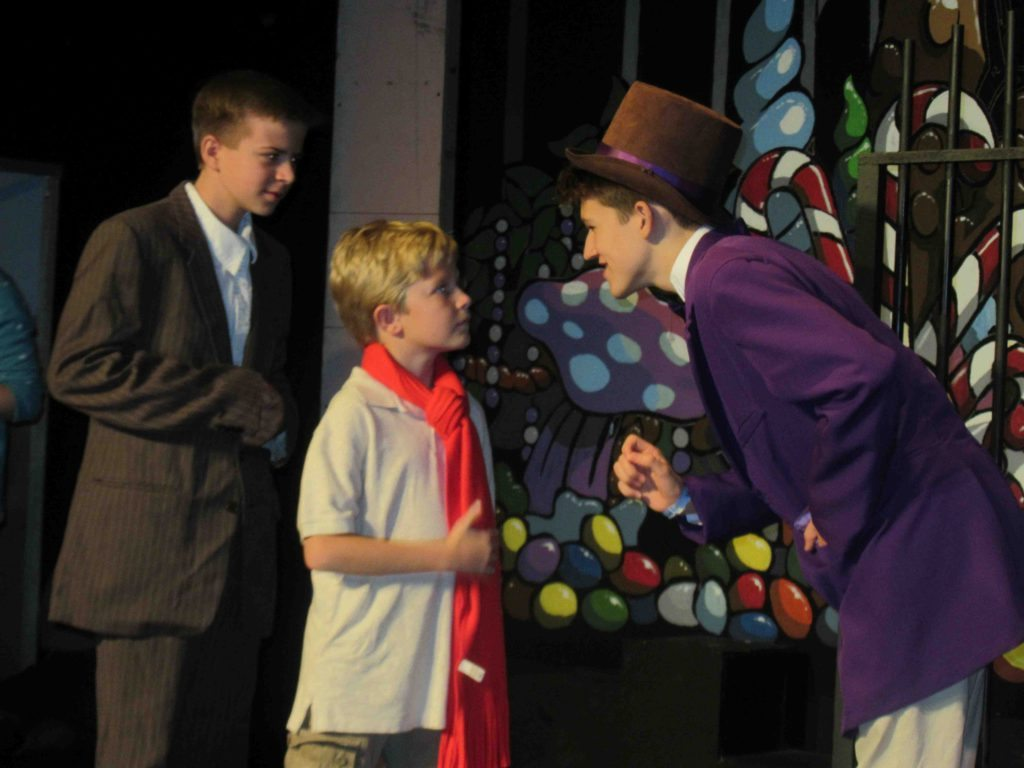 "Evan Culbertson as Grandpa Joe, Corban Adams as Charlie Bucket and Foster Hilding as chocolate factory owner Willy Wonka in ""Willy Wonka Jr."" at Spotlight Youth Theatre Sept. 2–18."