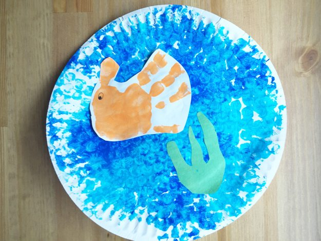 undersea6, orange hand print, green construction paper seaweed, textured plate