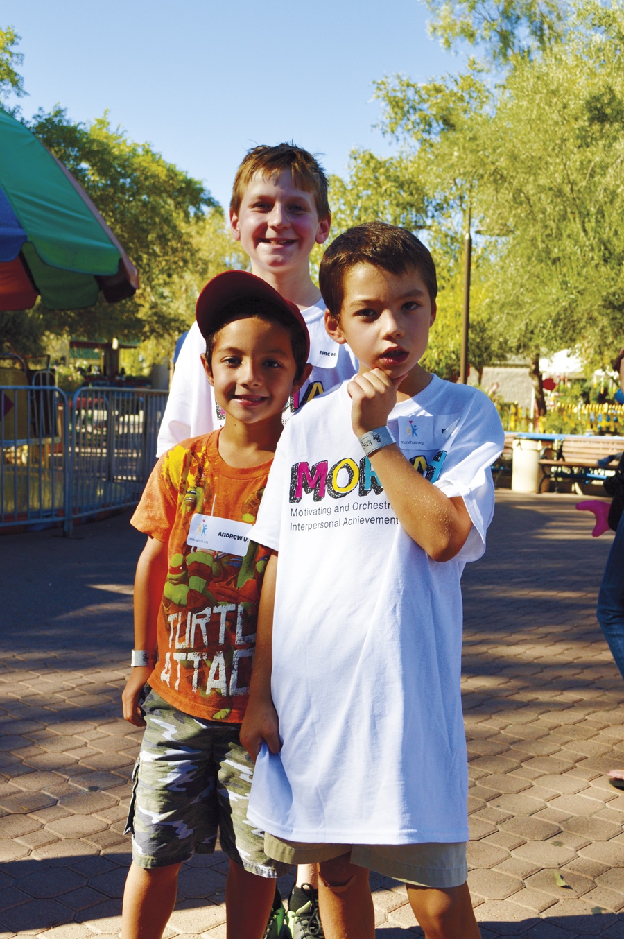 Right: Eric Meyer (background) spent the day with Noah Uhlenhake (right) and his brother Andrew.
