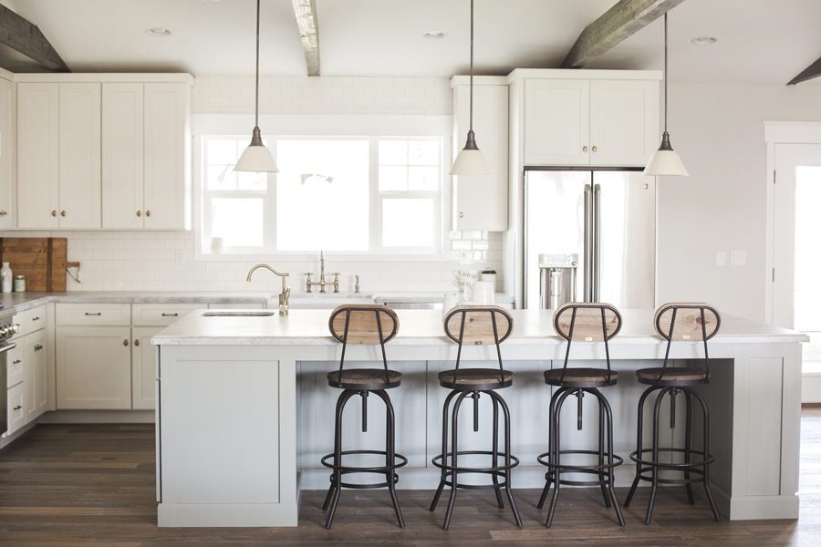 Open kitchens with oversize islands that serve as gathering places.