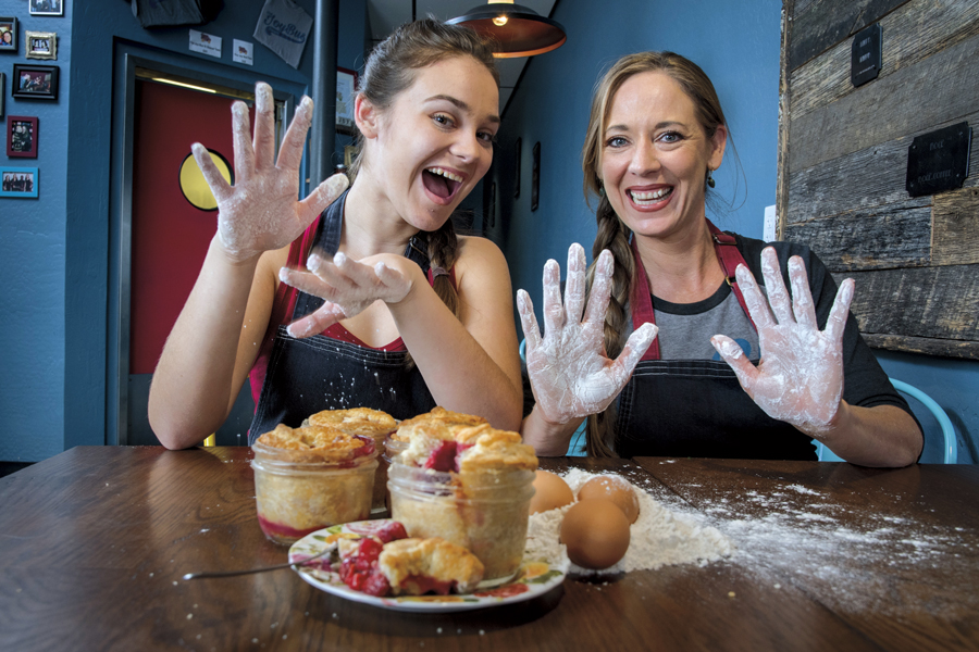 Jennifer Caraway and her daughter Areli Trapero (16) with Carol's Mason Jar Pies. Photos by Rick D'Elia.