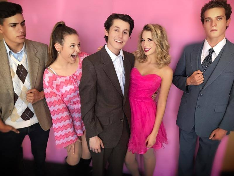 """Above are Jacob Herrera as Warner Huntington III, Lily Castle as Paulette Buonufonte, Sam Primack as Emmett Forrest, Addison Bowman as Elle Woods and Jeremy Bassham as Professor Callahan. """"Legally Blonde The Musical"""" comes to Glendale's Spotlight Youth Theatre May 26–June 11."""